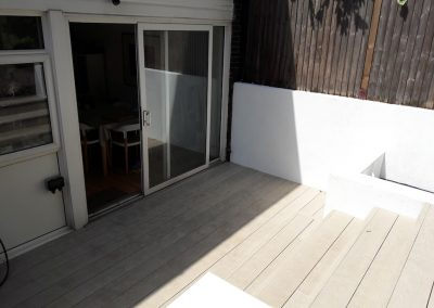 brown garden deck with steps