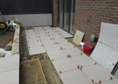 white garden patio tiles on the ground
