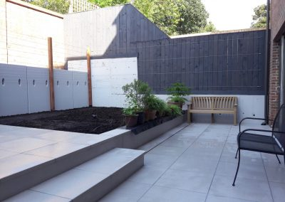 garden patio with flower bed and steps