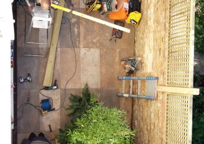 arial view of two men working on patio construction