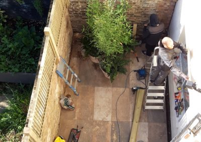 two men working on outdoor patio