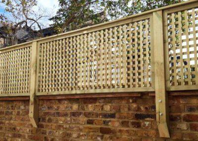 Trellis fence on brick wall