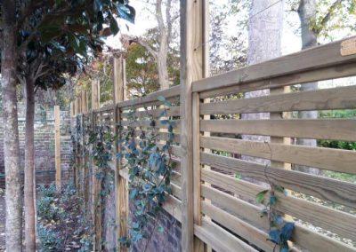 Wooden fencing around garden perimeter