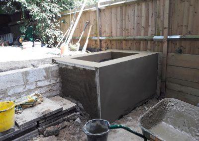 Concrete flower bed under construction