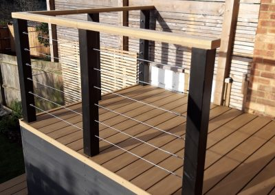 back garden decking with railing