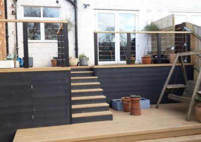 back garden patio with steps leading to decking