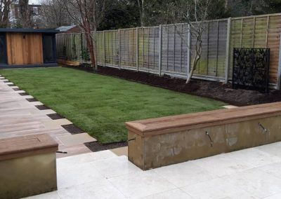 lawn and pathway leading to garden office