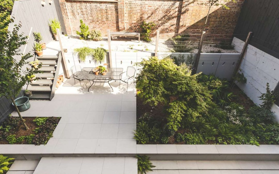 ariel view of garden with patio of white flagstones and grey steps