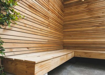 cedar bench with batten fencing in contemporary courtyard