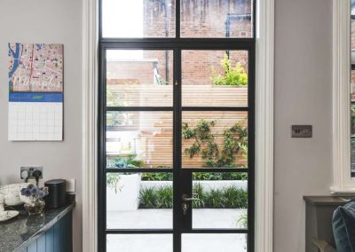 glass door leading from office to garden with similar flagstones
