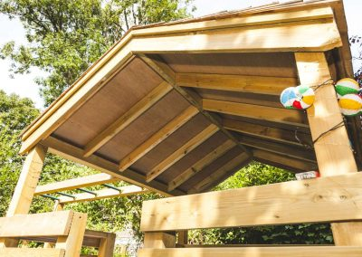 arched roof of children's wooden play platform