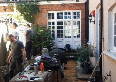 landscape gardeners working in a garden