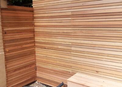 cedar batten fencing and concealed doorway