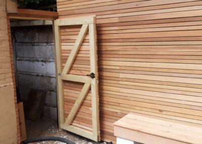 cedar batten fencing with concealed door