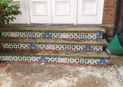 blue and green Moroccan style encaustic tiles for back door steps