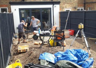 landscape gardeners constructing a garden