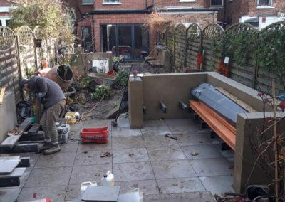 landscape gardener installing paving
