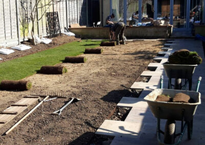 laying lawn in newly designed garden