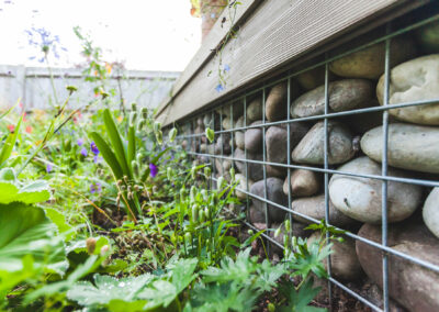 gabion cage with large stones in garden