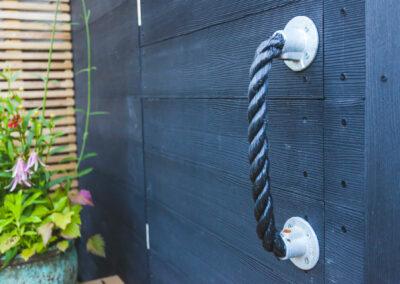 bespoke rope handle to a hidden access door