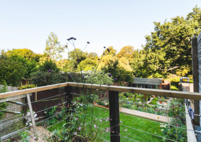 view from raised decking overlooking modern terraced garden