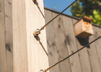 wire girders in wooden fence post