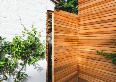 cedar batten door and fencing in backgarden
