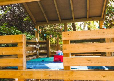 Children's wooden playing platform in garden