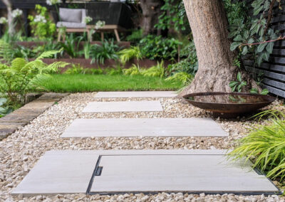 grey pavement slabs on gravel in contemporary garden
