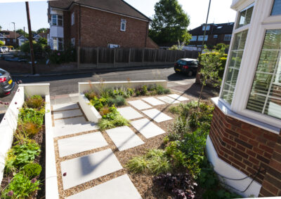 paving slabs in gravel in a low maintenance front garden