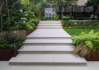 wide grey steps leading to contemporary garden