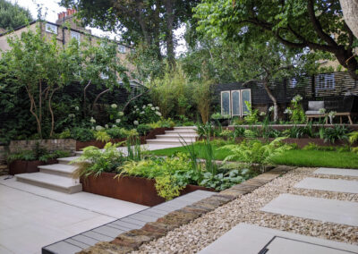 contemporary garden with raised planter boxes, decking, patio and seating area
