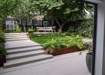 contemporary garden with large steps and raised decking