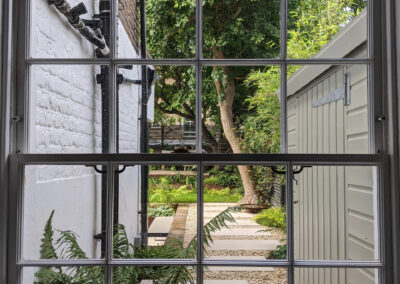 side passage view of garden from a large sash window