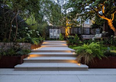 lighting casting light across steps leading to garden