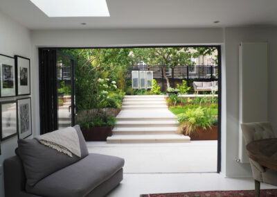 view leading from sitting room to the contemporary garden