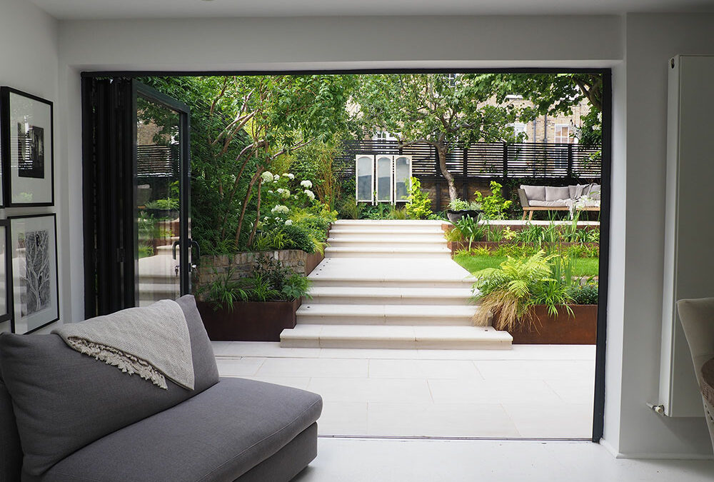grey steps leading to garden with plants on each side