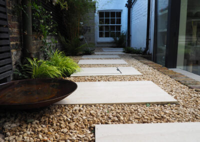 flagstones on gravel path leading to side of house