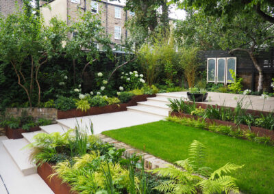contemporary garden with grey steps and recessed lighting