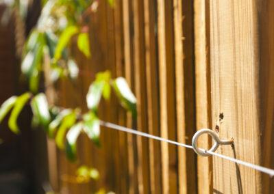 Cedar batten fencing with eye hooks