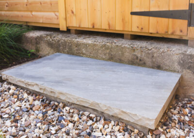 Kandla grey sandstone block on gravel path