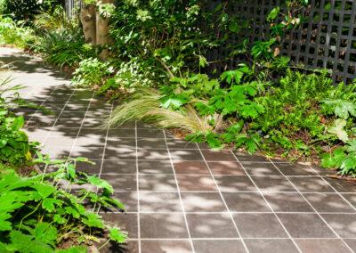 hand cut quarry tiles in contemporary garden