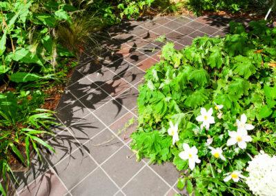 hand cut quarry tiles laid with plants surrounding border
