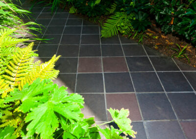 hand cut red and grey quarry tiles laid at a 45-degree angle