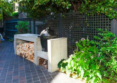 Kamado Joe barbecue in contemporary garden