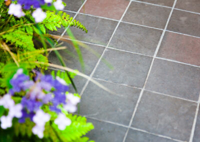 red and grey outdoor tiles with plants